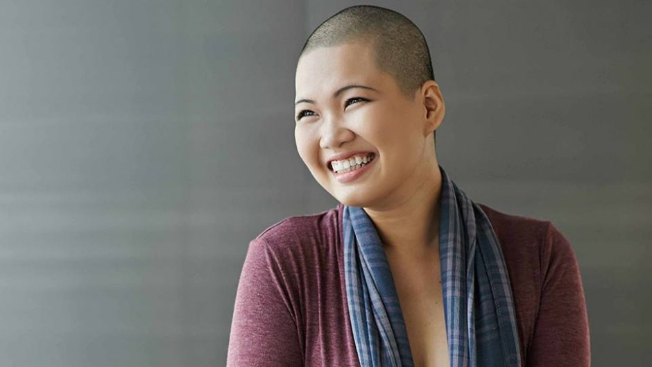 a-smiling-young-Asian-woman-with-shaven-head-representing-cancer-patient-after-chemo-therapy